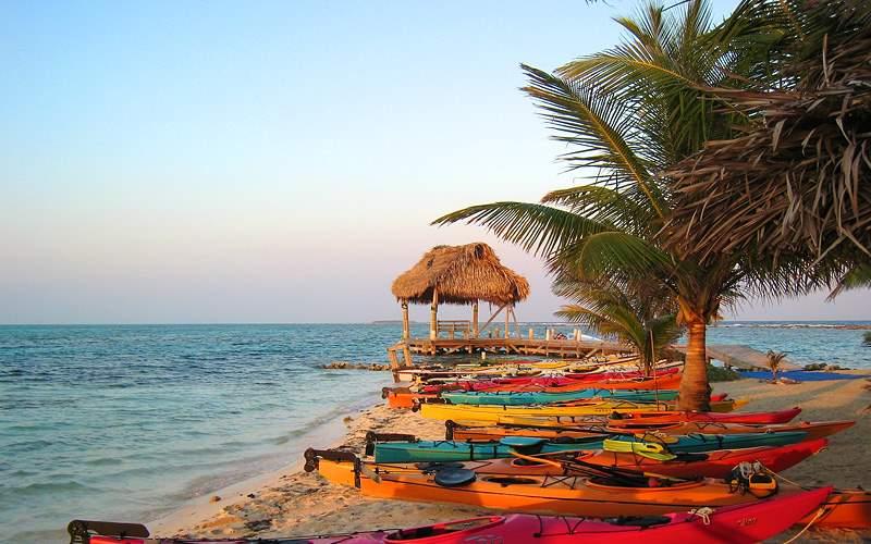 Belize beach with kayaks Royal Caribbean
