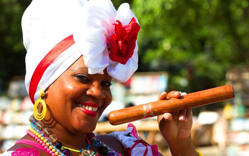 Woman with Authentic Cuban Cigar in Havana