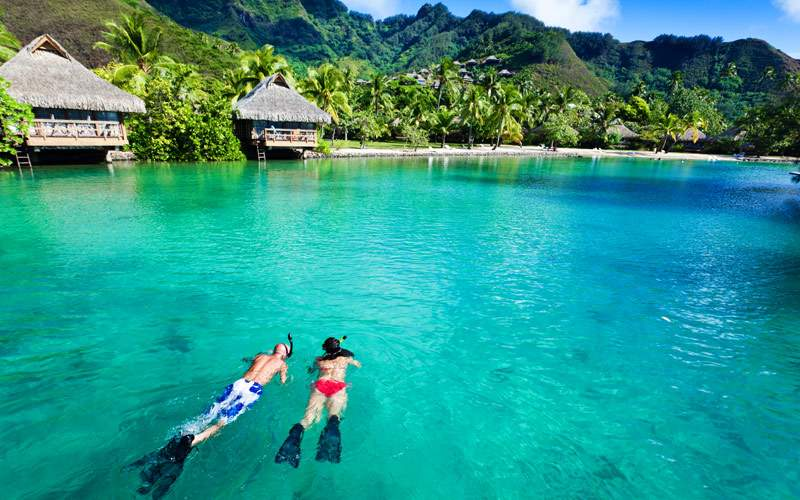 Snorkeling over coral reef in South Pacific