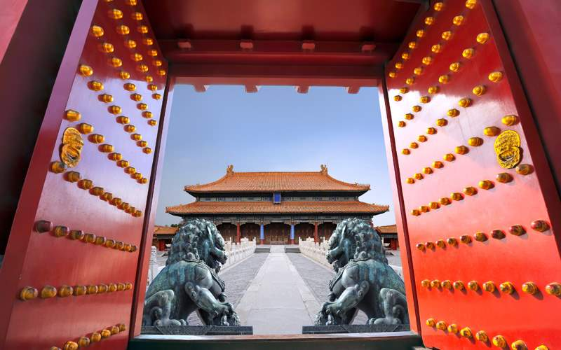 Red gate to the forbidden city in Beijing, China