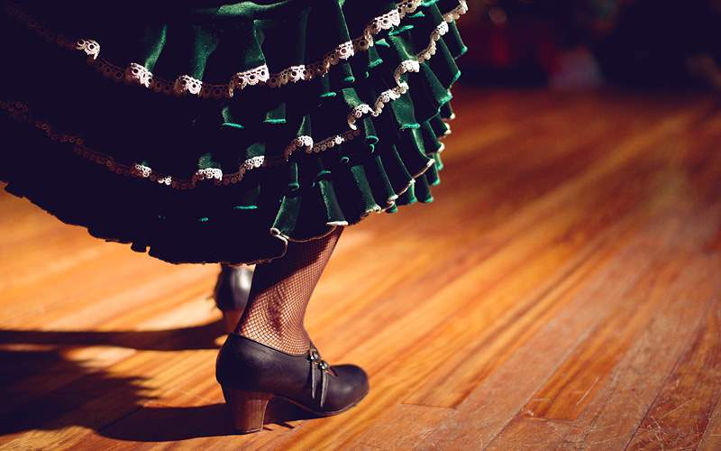 Women legs in flamenco skirt Azamra Club Cruises