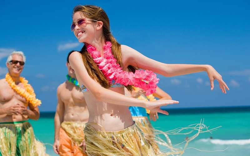 Girl learning how to hula Carnival Cruises Hawaii