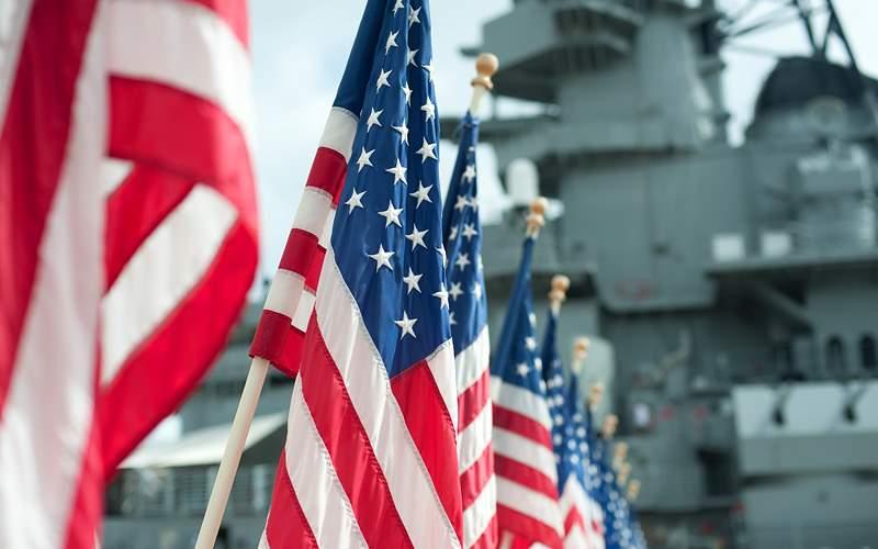 flags at Pearl Harbor Memorial Hawaii Carnival