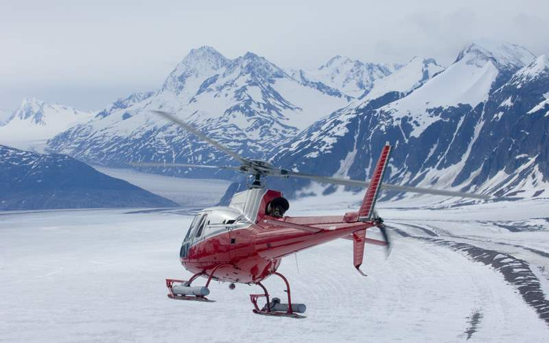 Helicopter flying over remote Alaskan glacier