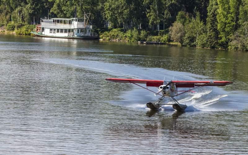 Float plane landing on Chena River in Fairbanks