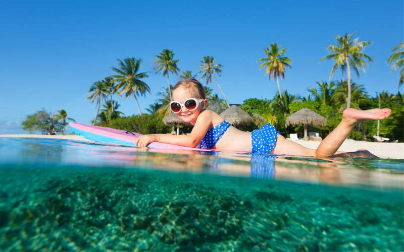 Girl swimming in tropical waters