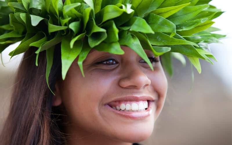 Hula girl wearing a handmade Polynesian head piece