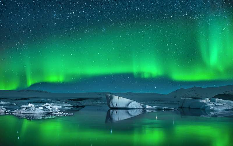 Icebergs under the Northern Lights in the Arctic
