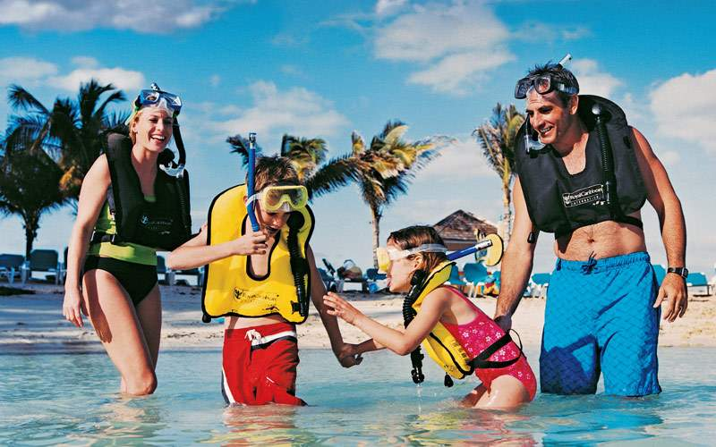 Family snorkeling in CocoCay
