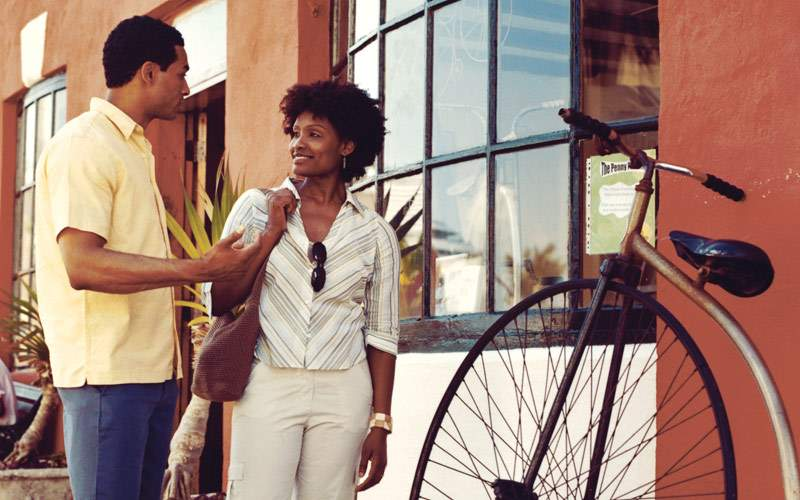 Couple outside a bike shop in Bermuda