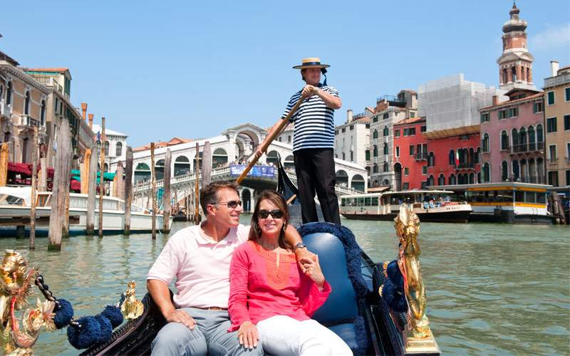 Couple on a gondola in Venice, Italy