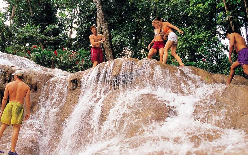 Guests enjoy playing on Jamaican waterfalls