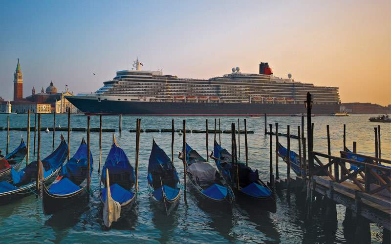 Cunard ship sails through Venice, Italy