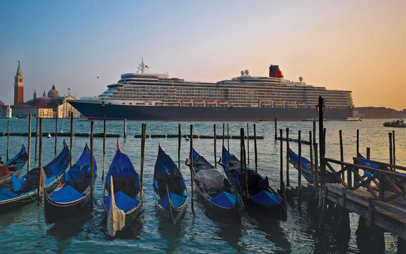Cunard ship sails through Venice, Italy