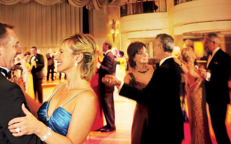 Couples in the ballroom dancing in formal wear