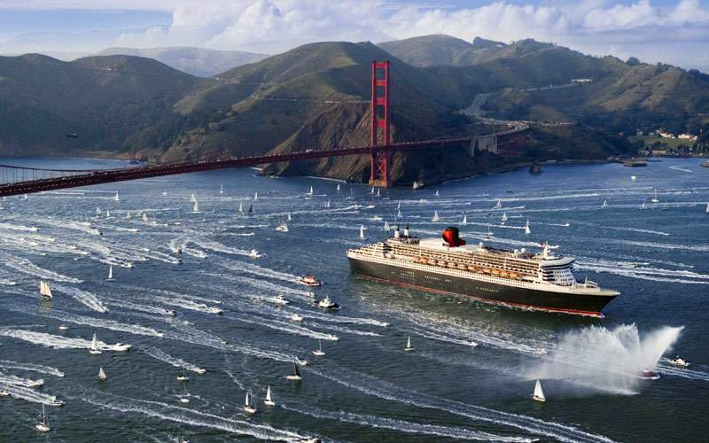 Queen Mary 2 sailing beneath Golden Gate Bridge
