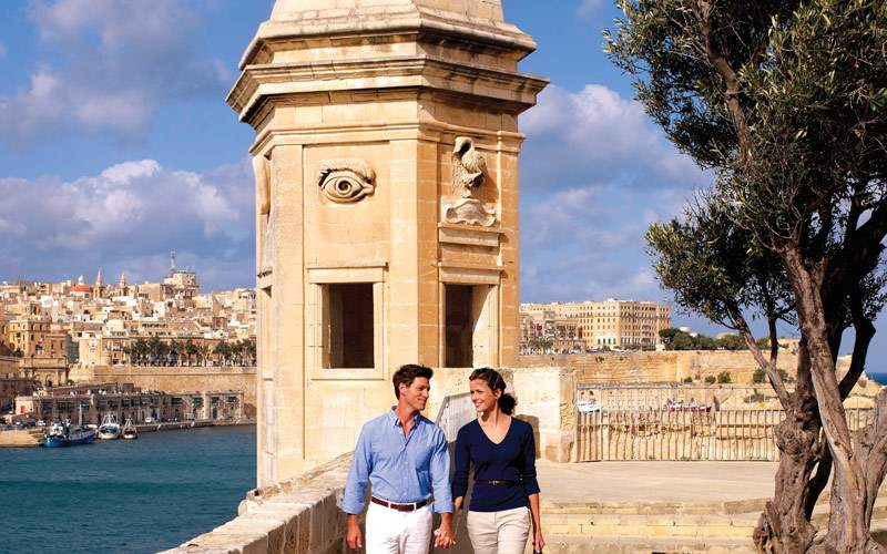 Seabourn cruise guests walking in Malta