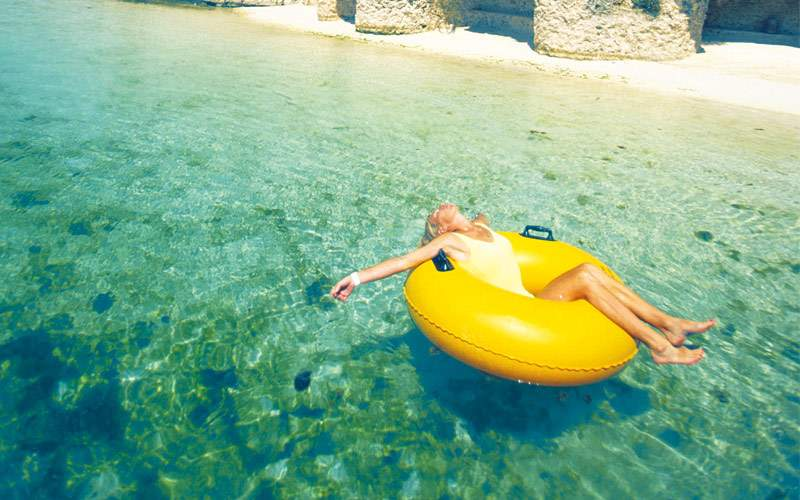 Woman relaxing in inner tube in the Caribbean