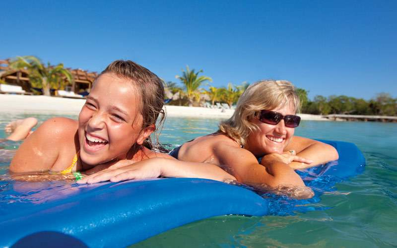Family enjoys floating on a raft in the Caribbean