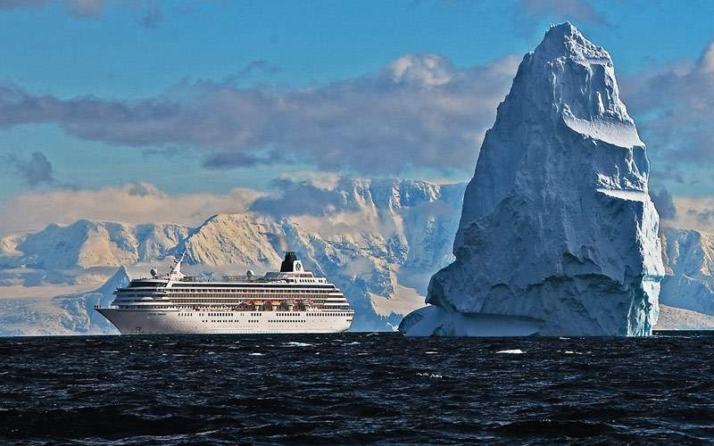 Crystal Symphony cruises past an iceberg