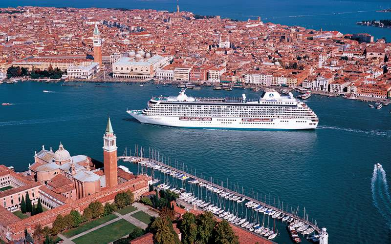 Crystal ship approaches Venice Italy