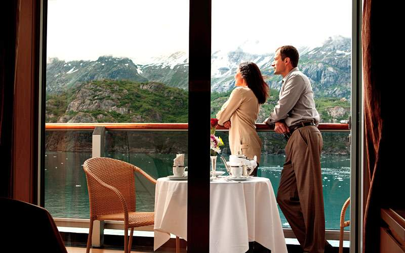 Guests enjoy their stay in their balcony cabin