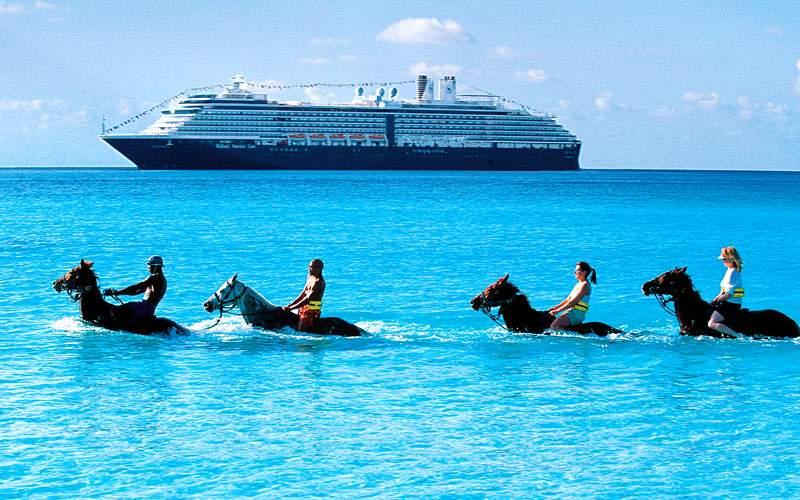 Guests ride horses in the Caribbean waters