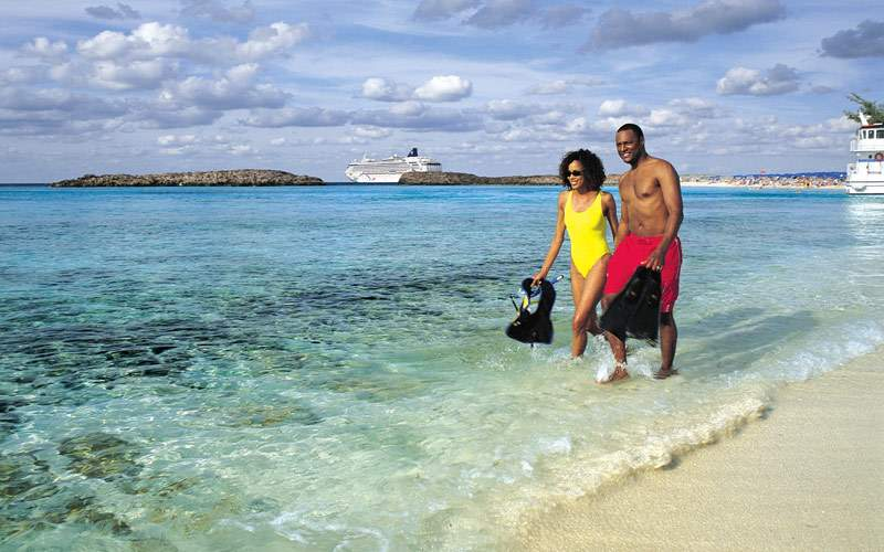 A couple enjoys a walk on Great Stirrup Cay