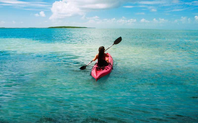 Guest kayaking through Great Stirrup Cay