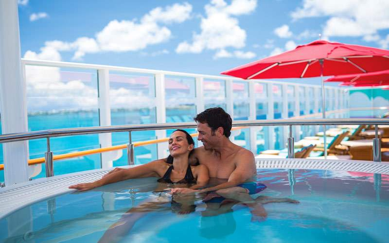 Couple enjoys the hot tub on a nice sailing day