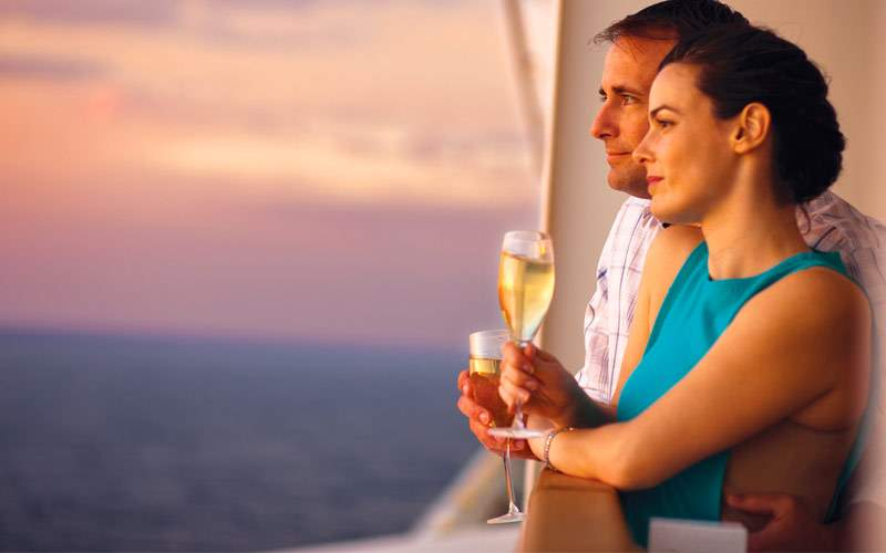 Guests drinking champagne during sunset