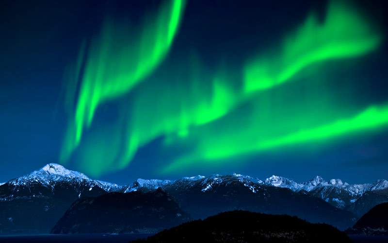Northern Lights over Mountains and lake
