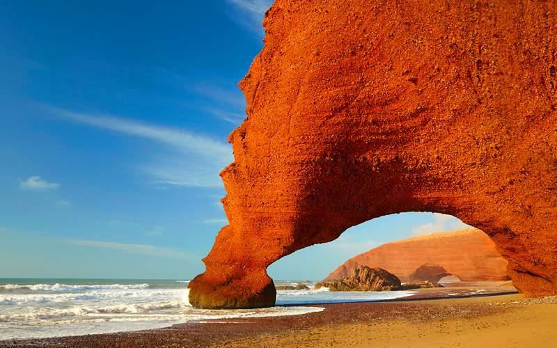 Red Arches on Atlantic Ocean Coast Morocco