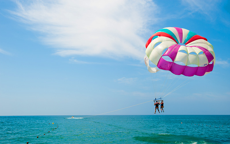 Parasailing tropical waters Southern Caribbean