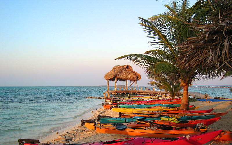 Belize beach with kayaks Royal Caribbean