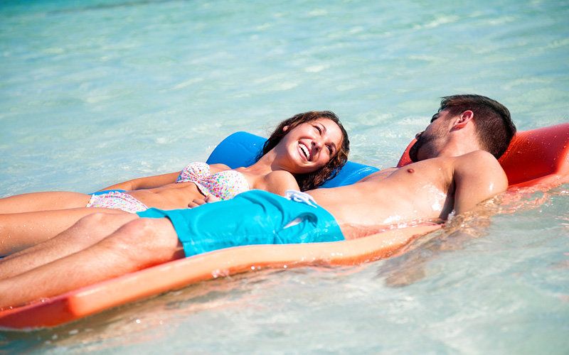 Couple in the water Celebrity Cruises Bahamas