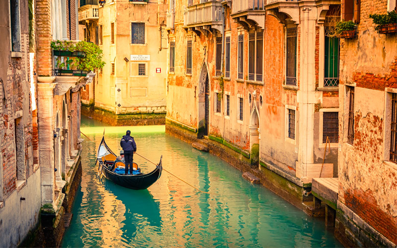Gondola on Canal in Venice Italy