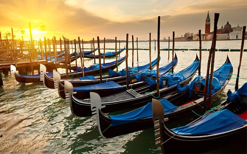 Gondolas sunrise Venice Italy