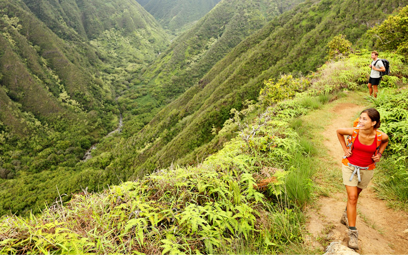 Hiking people on hawaii Waihee Ridge Trail Maui