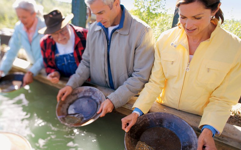 guests panning for gold in Alaska Holland America