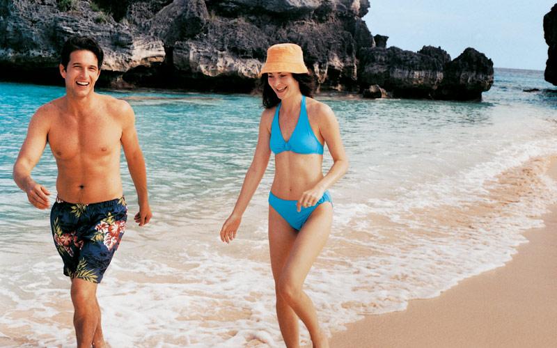 Couple walking on a beach in Bermuda