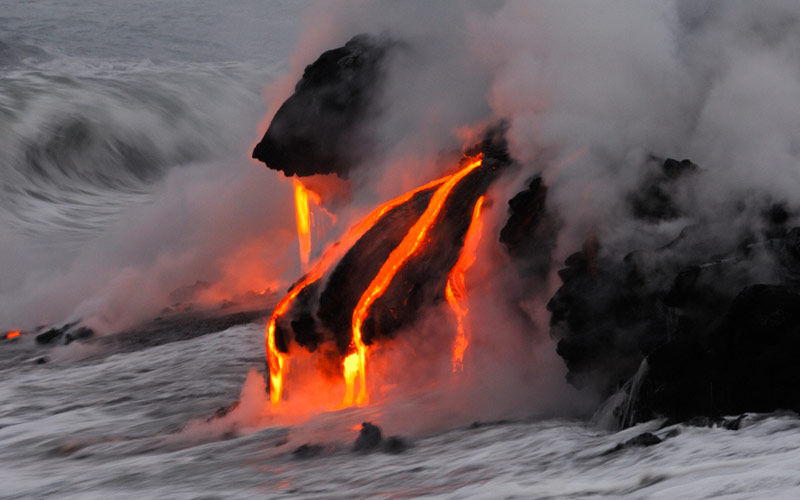 Volcano lava flows into the sea