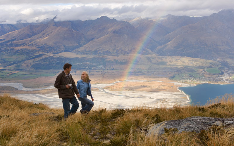 Couple enjoys the view of New Zealand after a hike