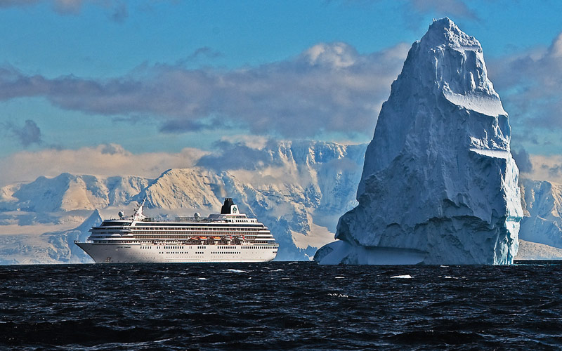 Crystal Symphony cruises past an iceberg