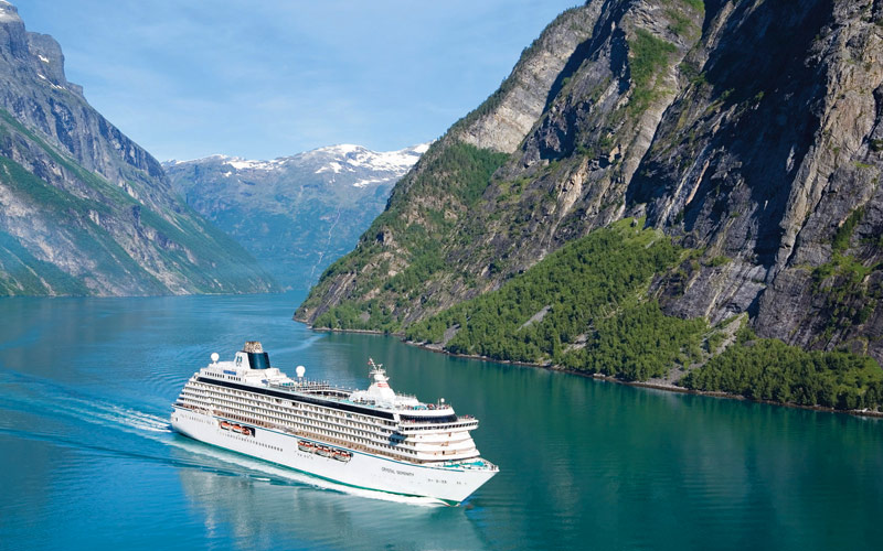 Crystal ship cruises through Geiranger fjord