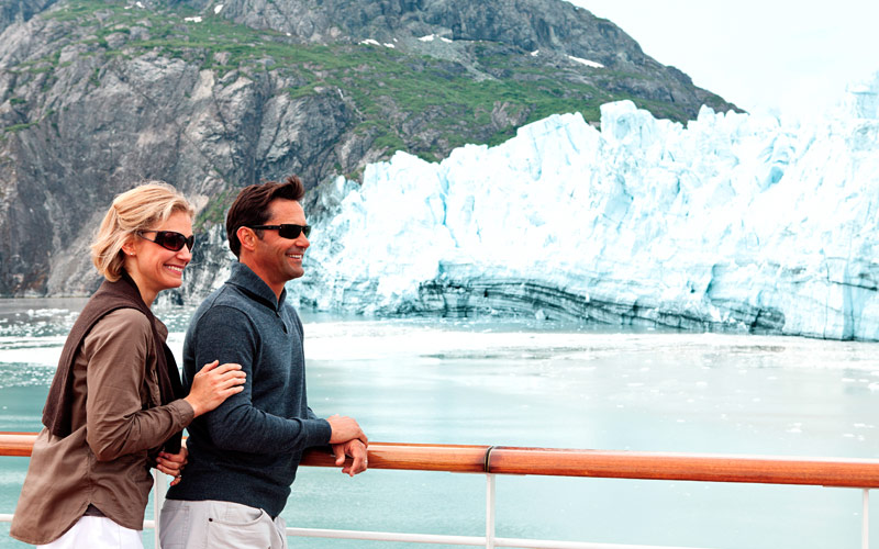 Couple looks out to the glaciers of Alaska