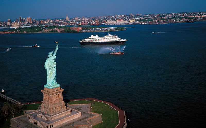 Ship sails past the Statue of Liberty