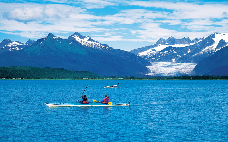 Guests kayaking through Juneau, Alaska