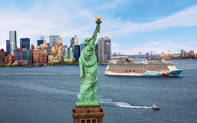 Norwegian Breakaway sails by the Statue of Liberty