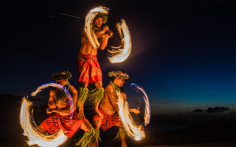 Men juggling fire in Hawaii